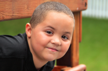 Photo of a young Latino boy playing outdoors.