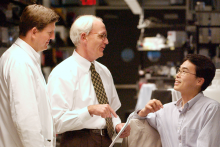 photo of Drs. Todd Brinton, Joseph Wu, and Paul Yock in the Clark Center